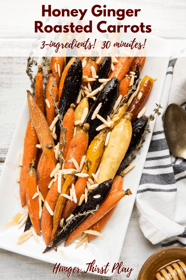 roasted carrots with honey, ginger and almonds on a plate