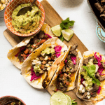 carne asada stuffed tacos with cabbage and guacamol