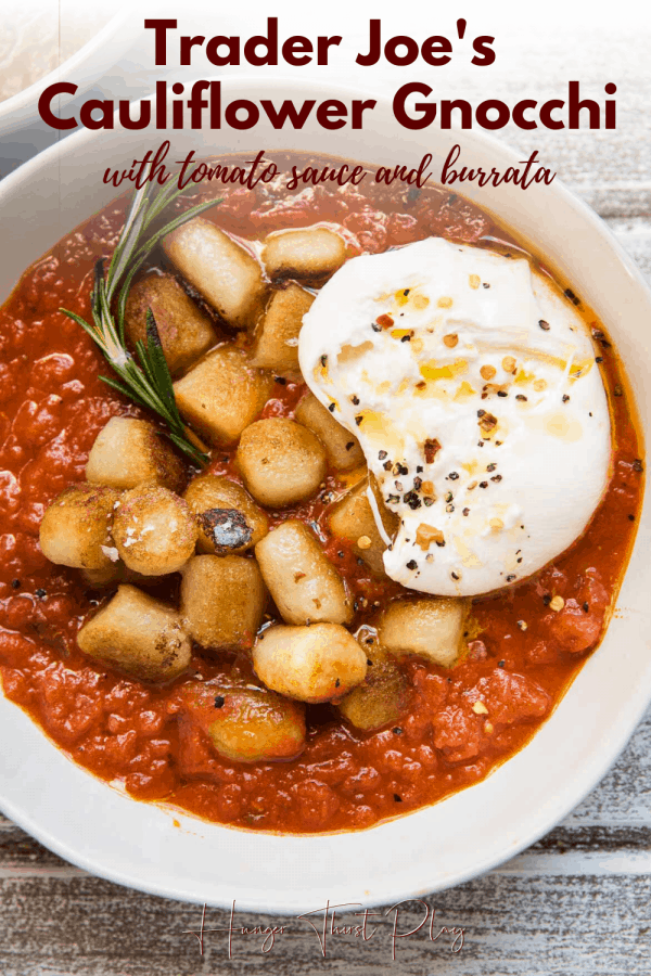 pan seared gnocchi sitting on marinara with a ball of burrata