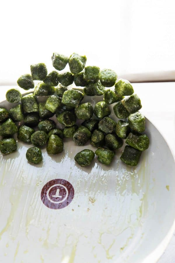 kale gnocchi being flipped in a saute pan