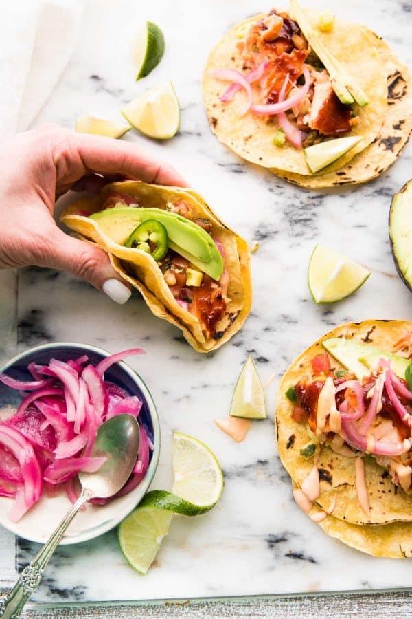 hand grabbing fish taco
