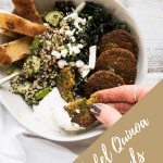 scooping tzatziki with a piece of falafel