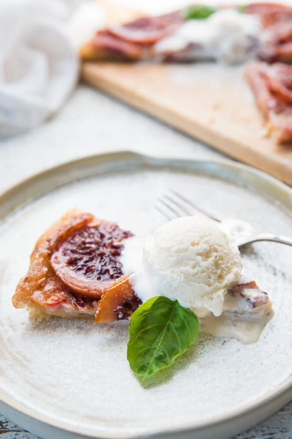 close up of ice cream on blood orange mascarpone tart