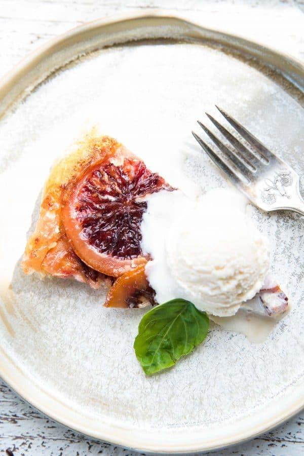 close of up blood orange mascarpone tart with vanilla ice cream