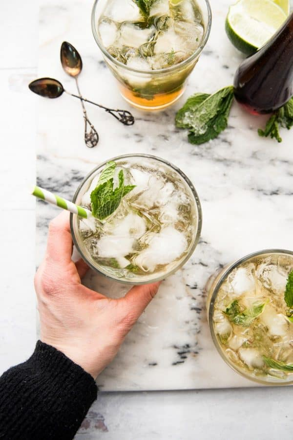 hand grabbing maple mint julep cocktail