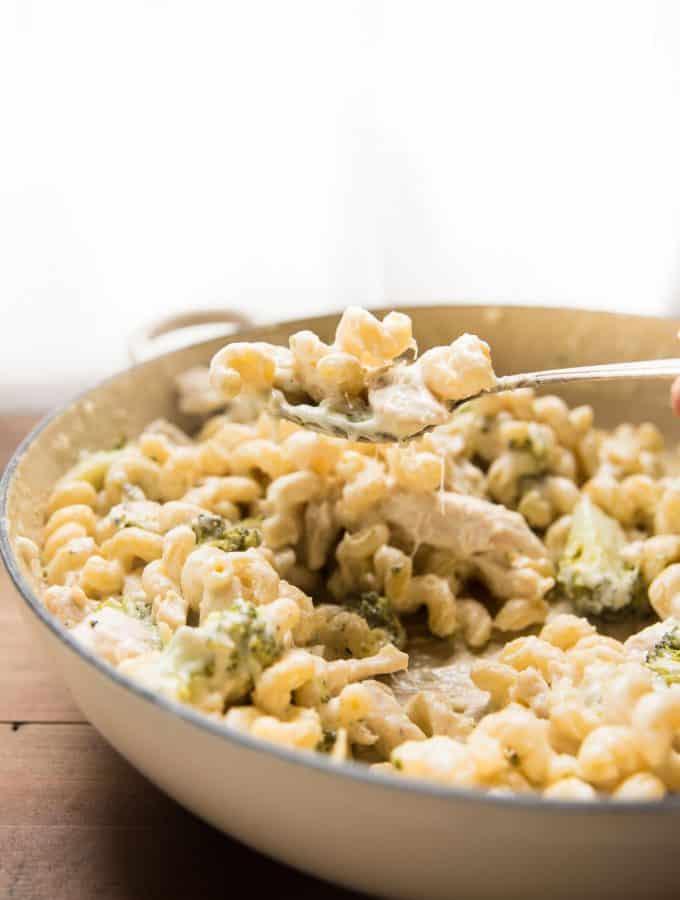 Cheesy scoop of alfredo pasta