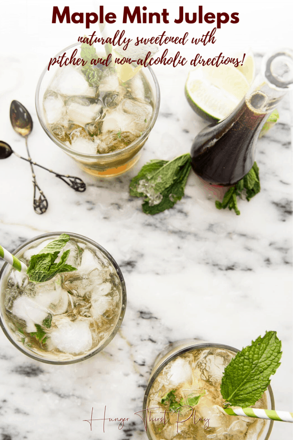 ice and mint filled cocktail glasses on marble