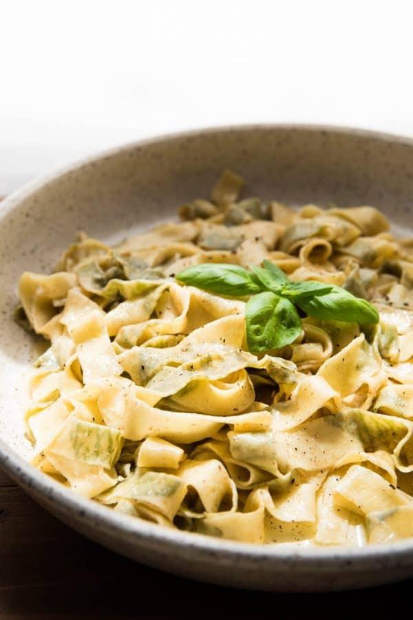 serving bowl full of basil stuffed handmade pasta
