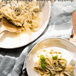 overhead close up of basil pappardelle wrapped around a fork and serving platter of pasta
