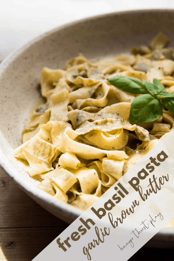 close up of basil pappardelle wrapped around a fork