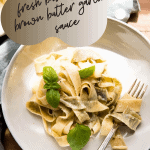 overhead close up of basil pappardelle wrapped around a fork