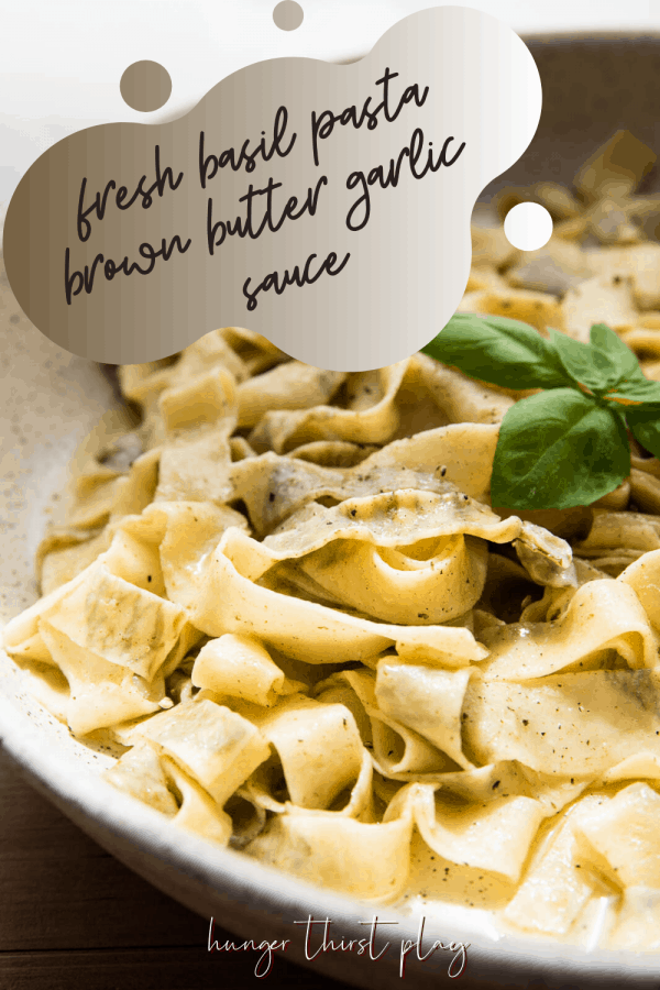 close up of homemade pasta with fresh basil