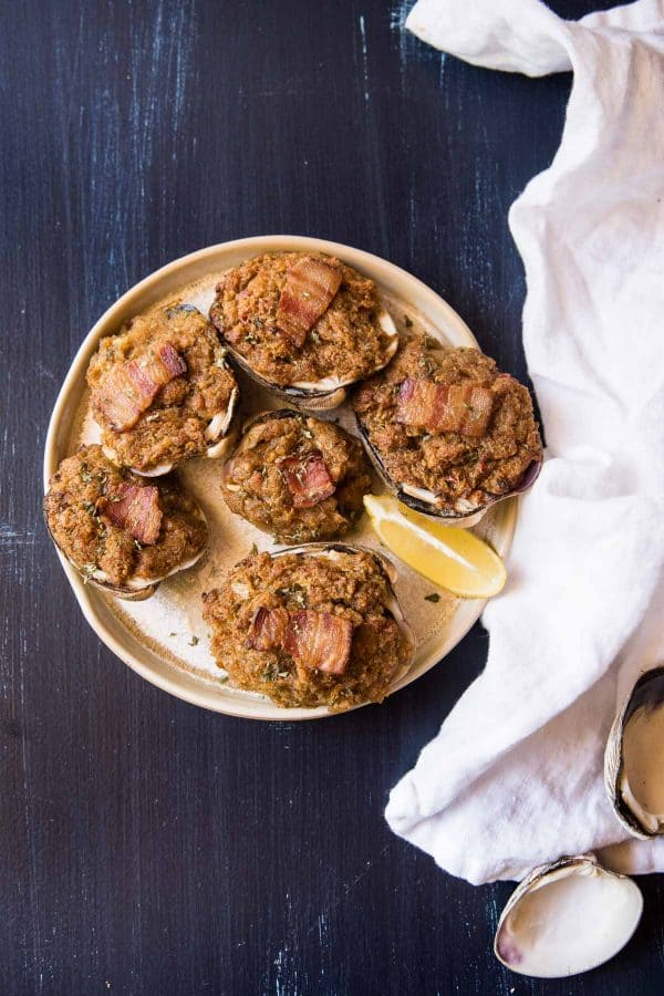 baked stuffed clams on a plate with fresh lemon