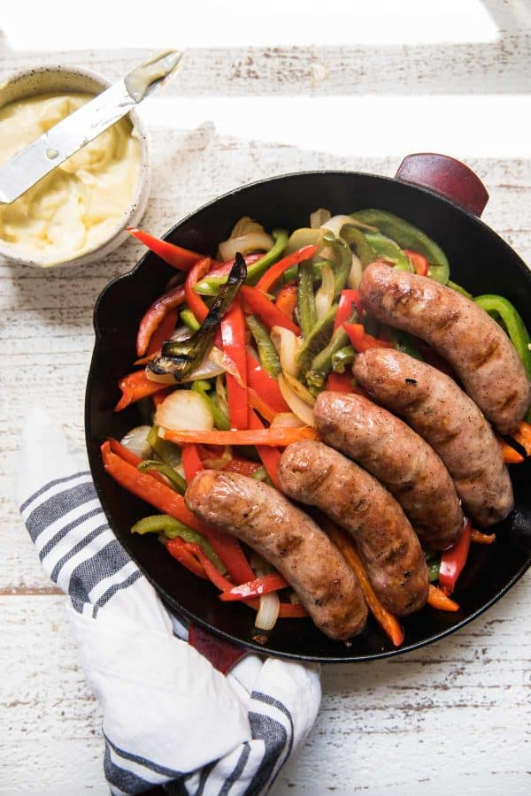 sausage and peppers in a cast iron skillet