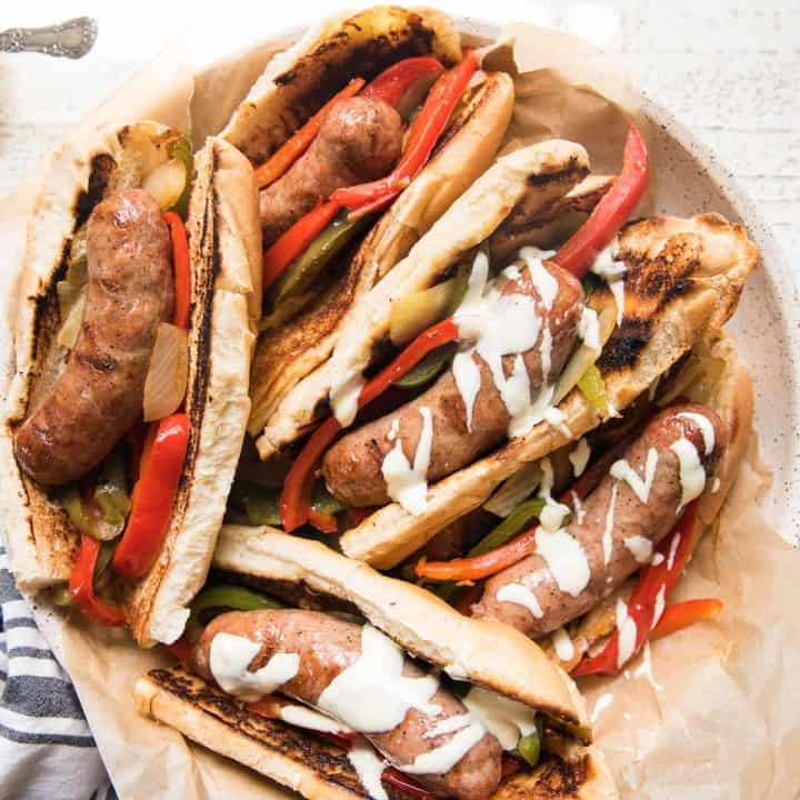 plate of sausage and peppers sandwiches