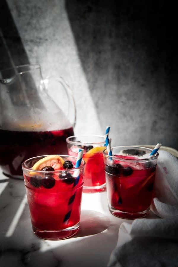 side angle of blueberry lemonade in glasses
