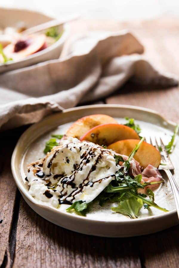 balsamic vinegar drizzled over burrata cheese