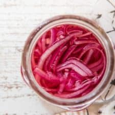 over head of pickled onions in a mason jar