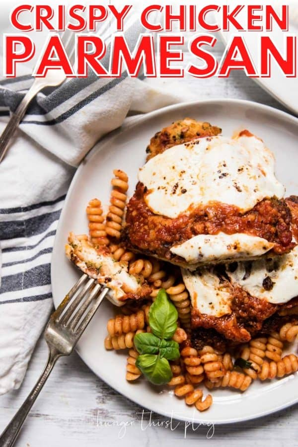 chicken parmesan over pasta on a plate
