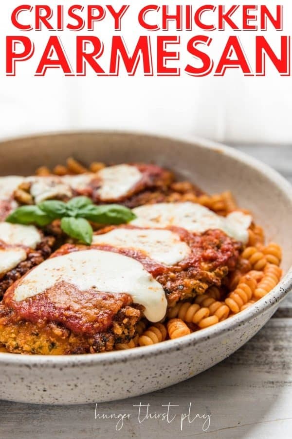 chicken parmesan over pasta on a platter