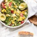 salad in a large platter with halibut fillets