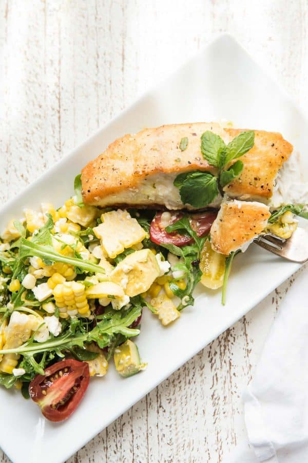forkful of halibut and corn salad