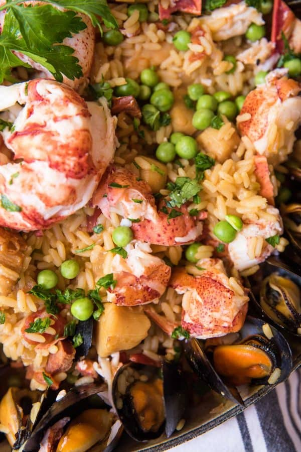 close up of rice peas and lobster