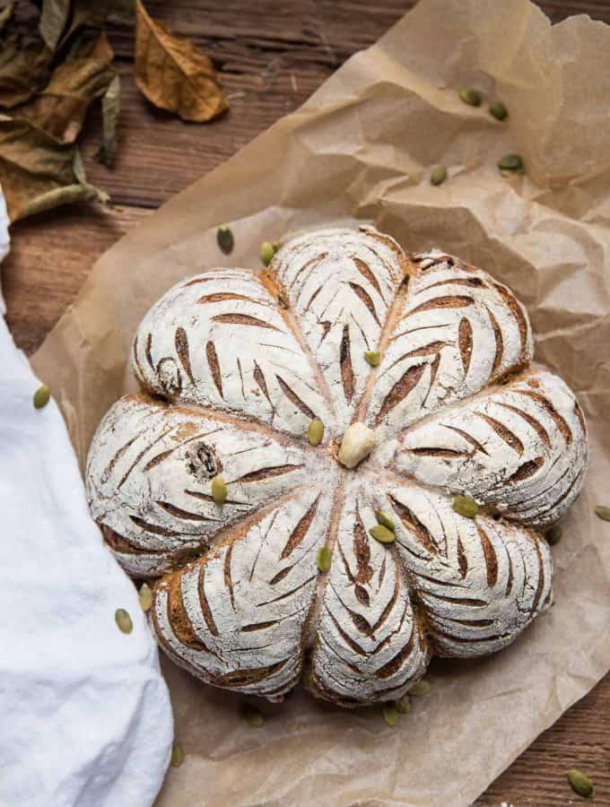 overhead of pumpkin shaped sourdough bread