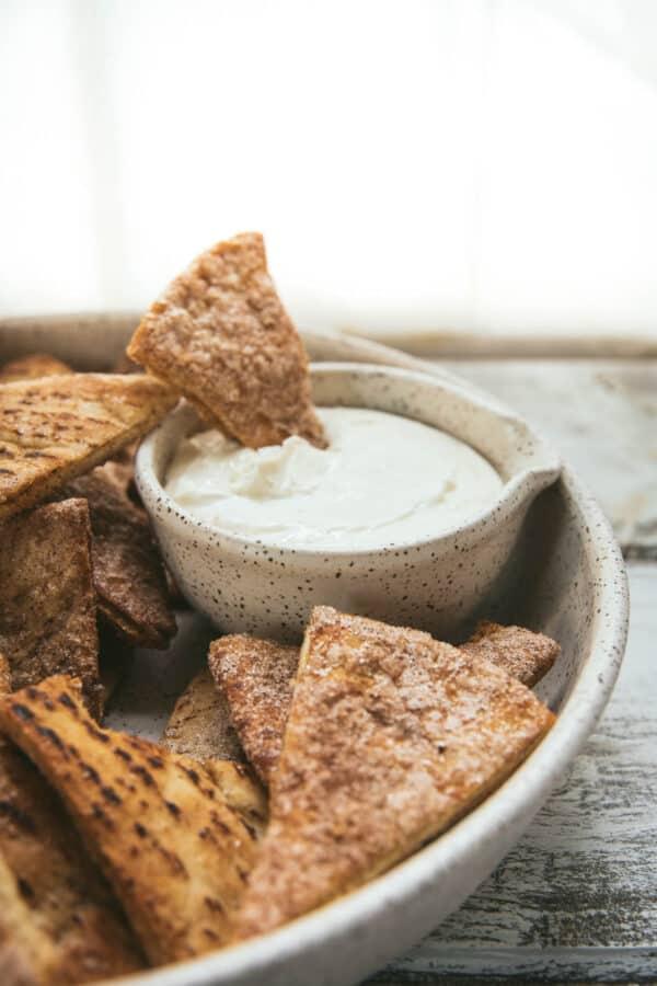 sweet chip dipping into creamy vanilla dip