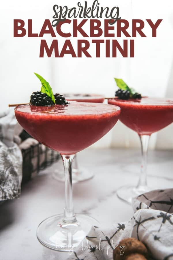 side angle of martinis with blackberry garnish