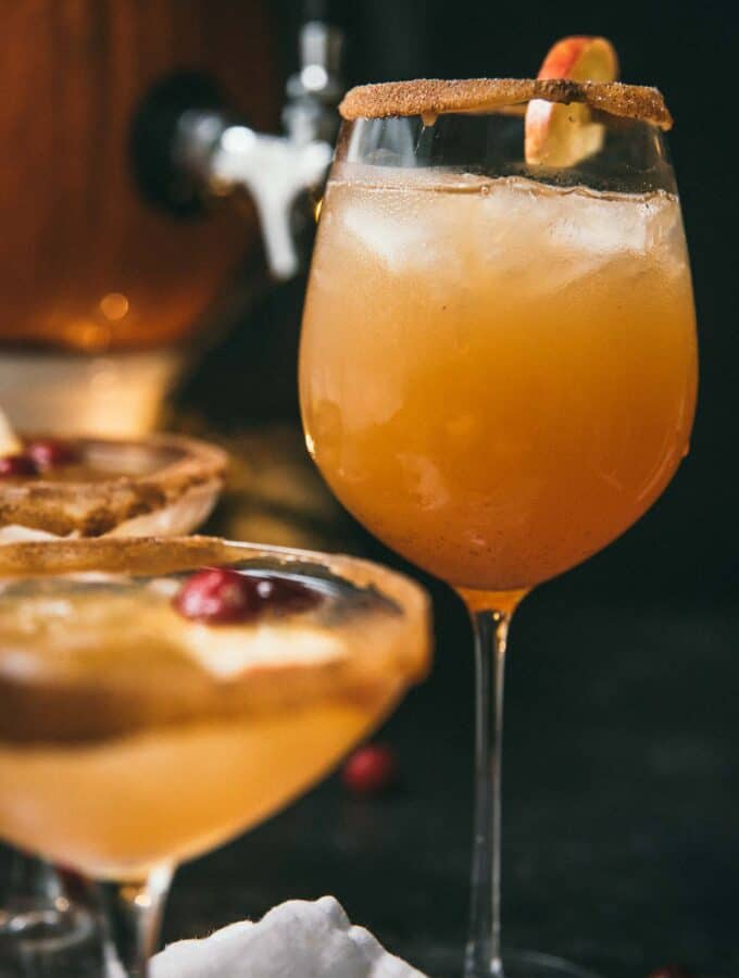 fall sangria in a cinnamon sugar rimmed wine glass