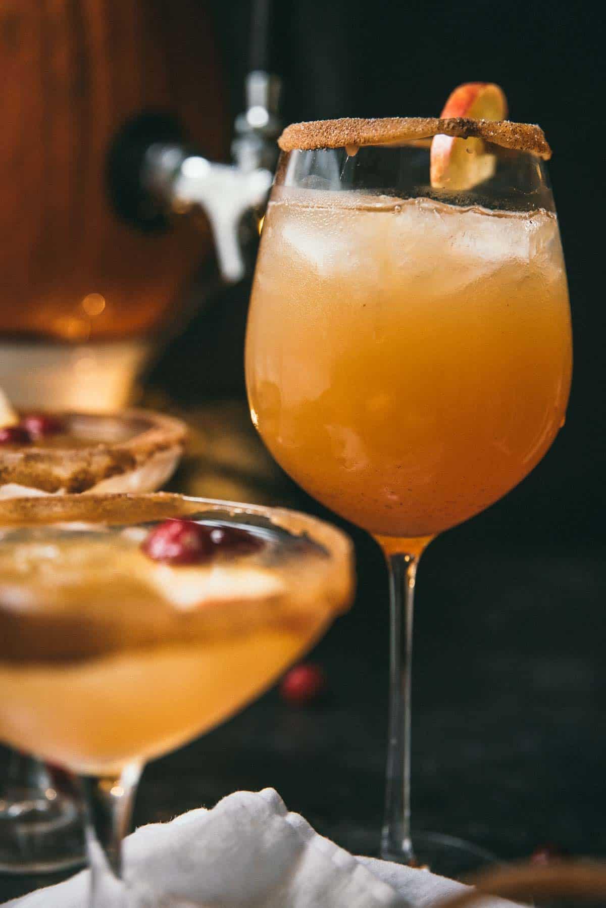 fall sangria in a cinnamon sugar rimmed wine glass