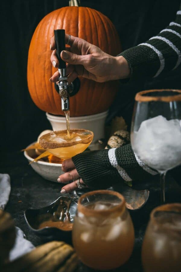pouring beverages out of a tapped pumpkin