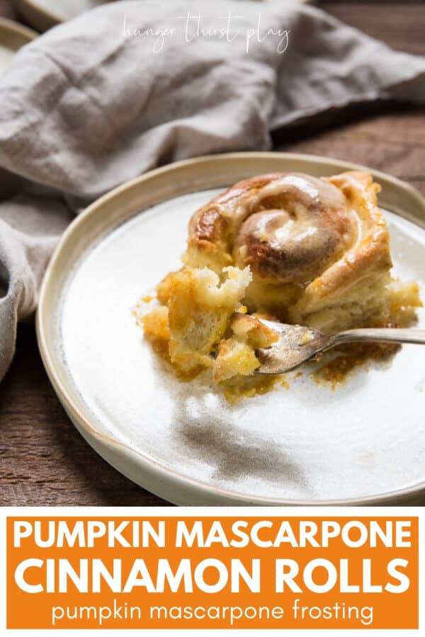 forkful of pumpkin cinnamon roll on a plate
