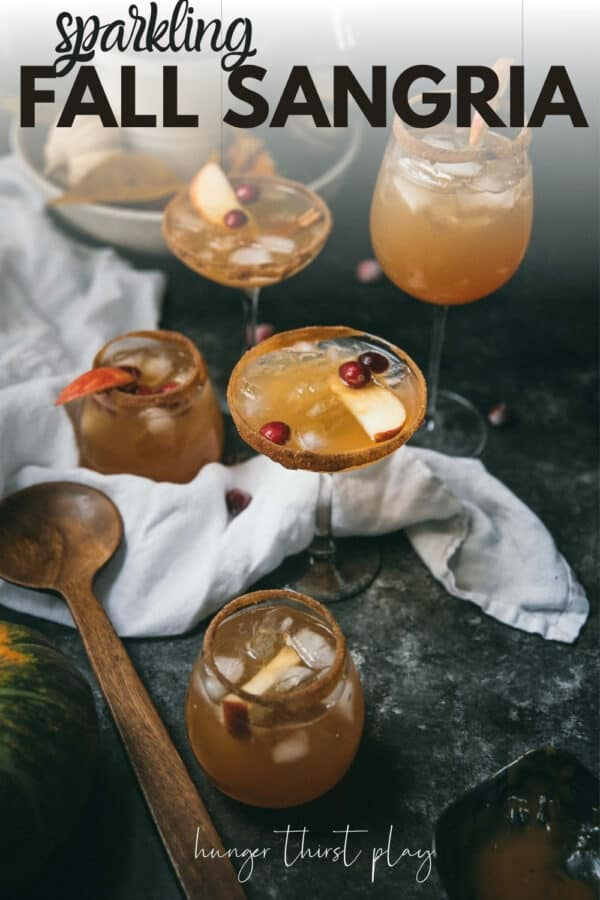 glasses on fall sangria with apple slices and cranberries