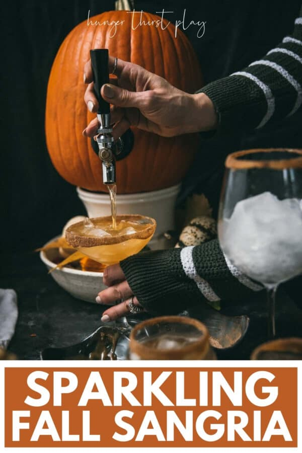 pouring sangria out of a tapped pumpkin