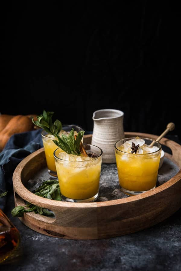 side angle of pumpkin smash cocktails on a drink tray