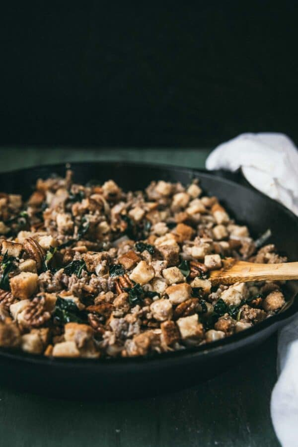 side angle of country style stuffing in a cast iron pan