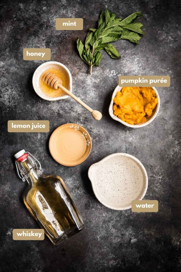 overhead photo of labeled ingredients for honey pumpkin whiskey smash