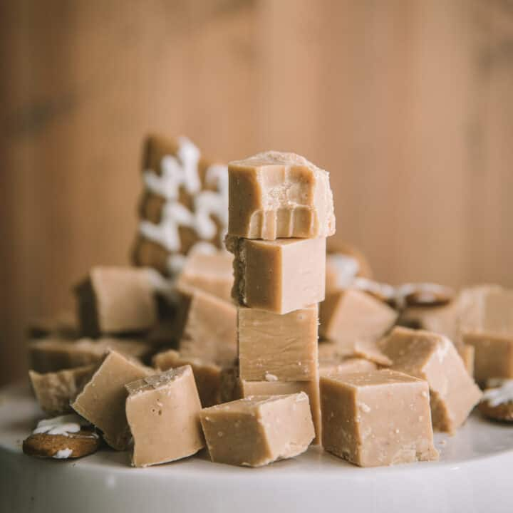 stacked pieces of fudge on a cake stand
