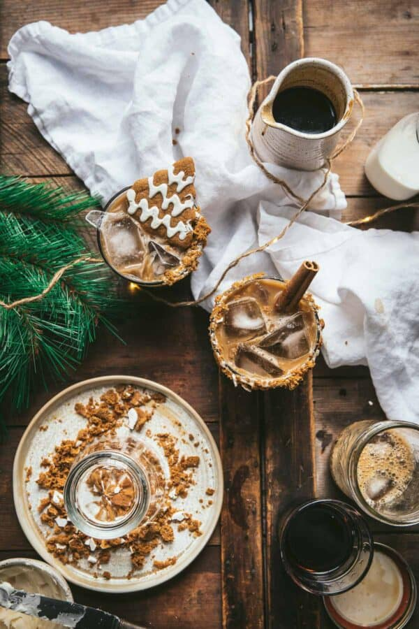 overhead of gingerbread white russians with plate for gingerbread rim