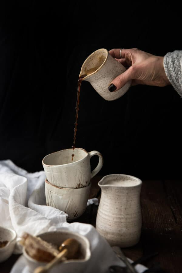 espresso pouring into stacked mugs