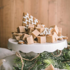 gingerbread fudge cut on a cake stand with cookies