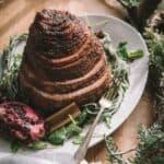 boneless spiral cut ham with glaze on a platter