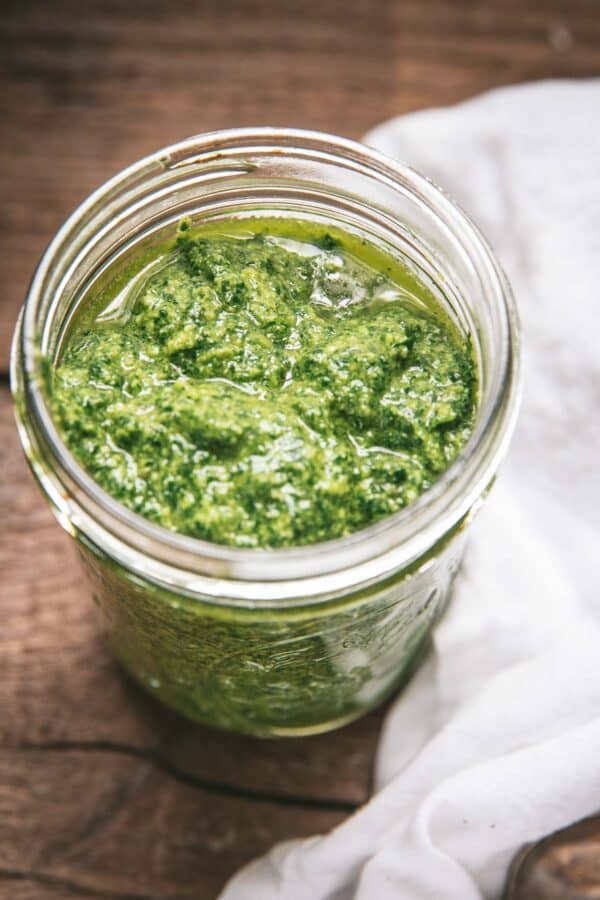 close up of pesto in jar