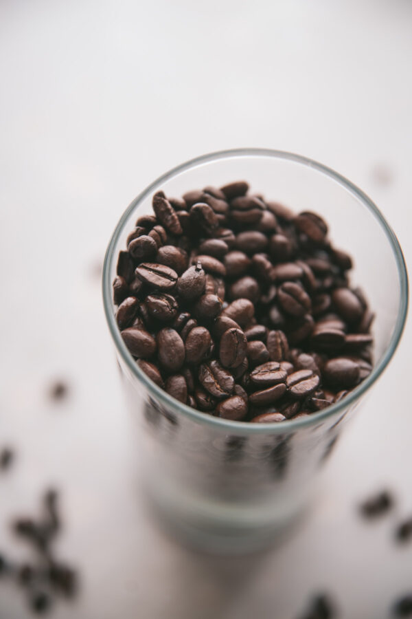close up of coffee beans in a glass