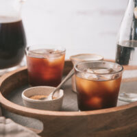 cold brew coffee in short glasses with ice cubes