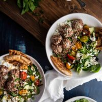 overhead photo of quinoa bowls with meatballs