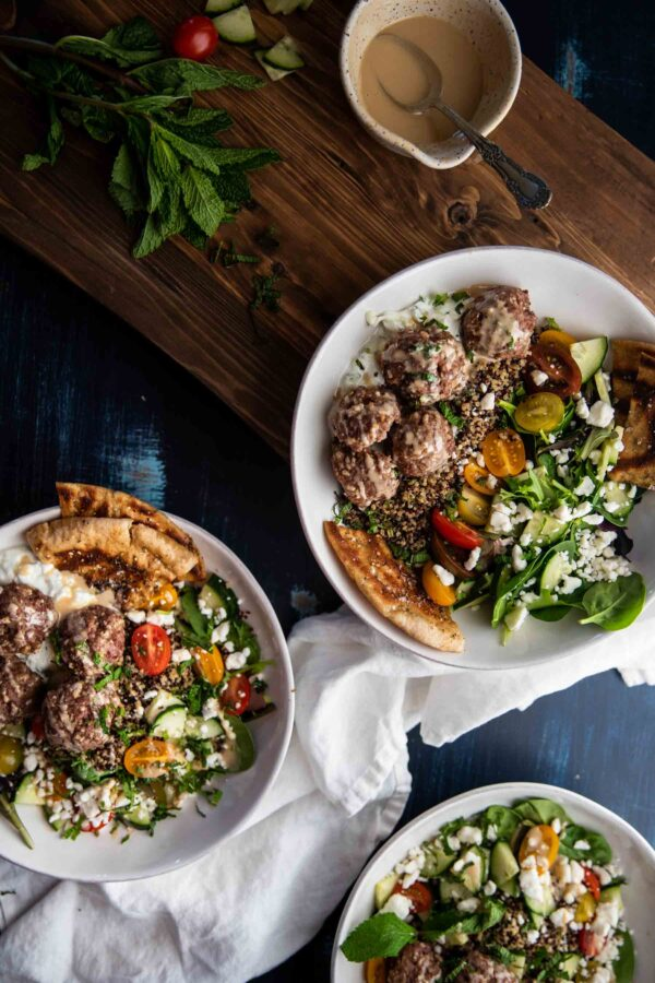 overhead photo of mediterranean quinoa bowls with meatballs