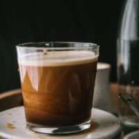 close up of nitro cold brew settling in a glass